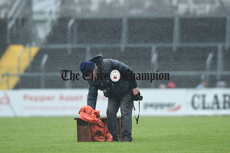 Seamus O Reilly dries the team bench before match in Ennis. Photograph by John Kelly.