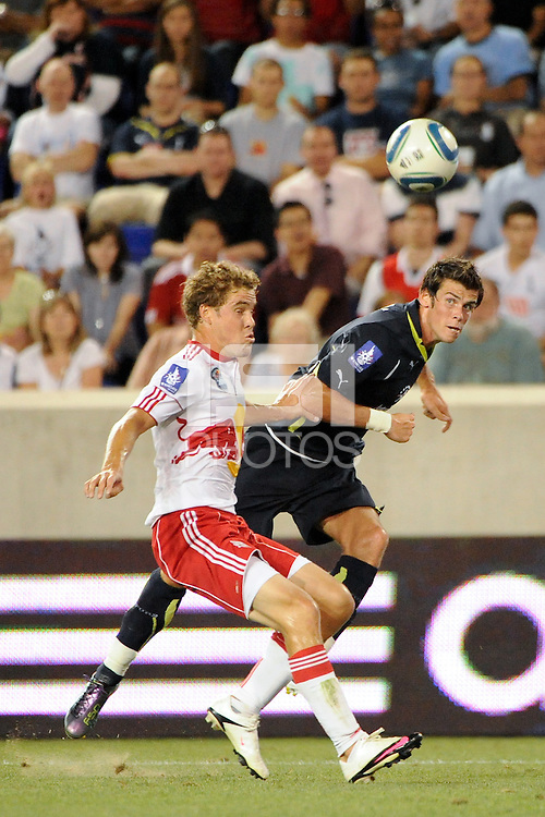 Garreth Bale (3)  of Tottenham Hotspur F. C. crosses past Chris Albright (3) of the New York Red Bulls. Tottenham Hotspur F. C. defeated the New York Red Bulls 2-1 during a Barclays New York Challenge match at Red Bull Arena in Harrison, NJ, on July 22, 2010.
