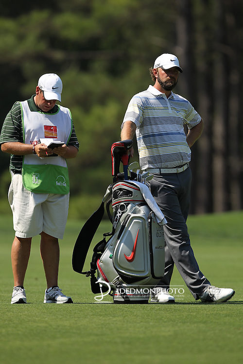 May 8,2011 - Lucas Glover and his caddy look over the fairway on number ten.  Lucas Glover wins the tournament in sudden death over Jonathan Byrd at Quail Hollow Country Club,Charlotte,NC.