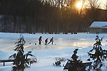 At least children who like hockey like this bone chilling weather, as temperatures around 10 and a steady wind didn't seem to curb their enthusiasm,  at Sunset Friday, January 5, 2018, at Charter Oak Park in Manchester. (Jim Michaud / Journal Inquirer)