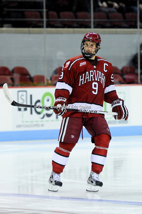 Harvard Crimson defenseman Danny Biega (9) during the Harvard University at Boston University NCAA hockey match held at the Agganis Arena in Boston Massachusetts.   Eric Canha/CSM