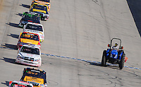 May 30, 2008; Dover, DE, USA; Nascar Craftsman Truck Series drivers pass a tractor blowing off the track under caution during the AAA Insurance 200 at Dover International Speedway. Mandatory Credit: Mark J. Rebilas-US PRESSWIRE.