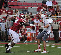 STAFF PHOTO ANTHONY REYES &bull; @NWATONYR<br /> Cordale Boyd (69) Razorbacks defensive lineman, pressures Beaux Hebert Nicholls State quarterback in the fourth quarter Saturday, Sept. 6, 2014 at Razorback Stadium in Fayetteville. The Hogs won 73-7.