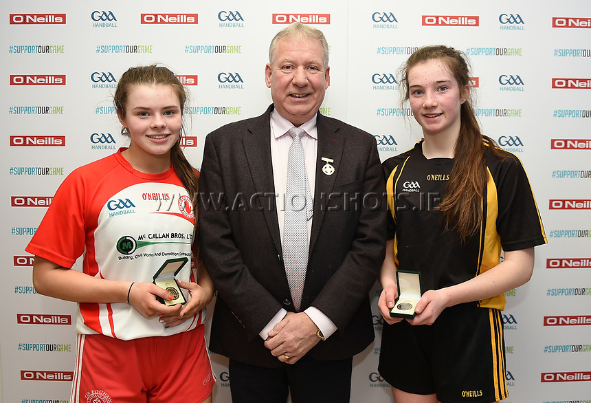 19/03/2018; 40x20 All Ireland Juvenile Championships Finals 2018; Kingscourt, Co Cavan;<br /> Girls Under-16 Singles; Kilkenny (Rois&iacute;n O&rsquo;Keefe) v Tyrone (Mairead Fox)<br /> Roisin O'Keefe and Mairead Fox with GAA Handball President Joe Masterson<br /> Photo Credit: actionshots.ie/Tommy Grealy