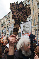 "Moscow, Russia, 06/05/2013..A man holds a sign ""There is no law in Russia"" in Bolotnaya Square as some 20,000 demonstrators protested against Russian President Vladimir Putin and demanded the release of political prisoners. The demonstration marked the first anniversary of a protest that descended into violence between protestors and police and resulted in over 600 arrests."