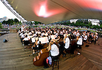 The Charlotte Symphony, led by conductor Albert-George Schram, performs during the Summer Pops Series 2008, at SouthPark Mall.