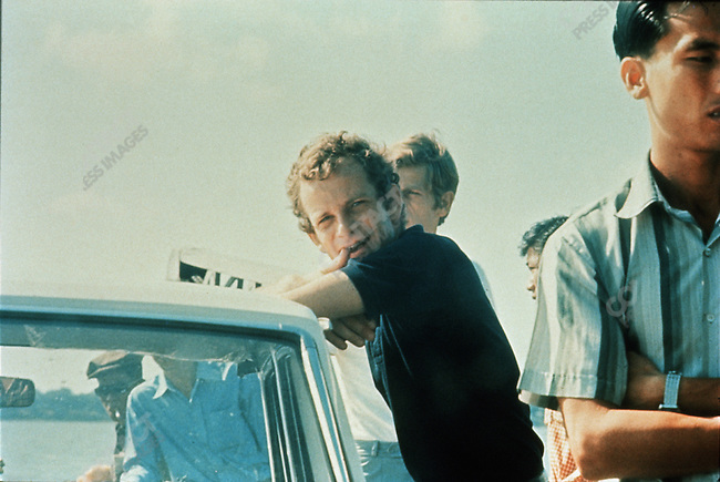 Gilles Caron on a ferry boat crossing the Mekong river, Cambodia, April 3, 1970. The last known photograph of him before his disappearance.