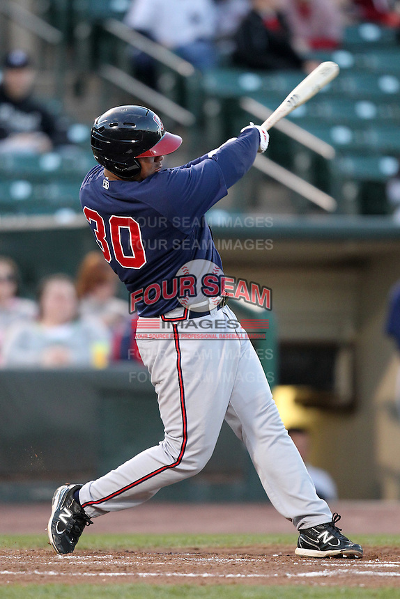 Gwinnett Braves outfielder Mauro Gomez #30 at bat during a game against the Rochester Red Wings at Frontier Field on May 5, 2011 in Rochester, New York.  Rochester defeated Gwinnett by the score of 3-2.  Photo By Mike Janes/Four Seam Images