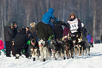 Paige Drobny passes spectators on Long Lake afer leaving the restart at Willow, Alaska  Iditarod sled dog race Sunday, March 3, 2013.