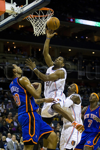 Charlotte Bobcats forward Stephen Graham (23) shoots the ball against New York Knicks forward Jared Jeffries (20) during an NBA basketball game at Time Warner Cable Arena in Charlotte, North Carolina October 30, 2009. Photo by Icon SMI/actionplus. UK Licenses Only