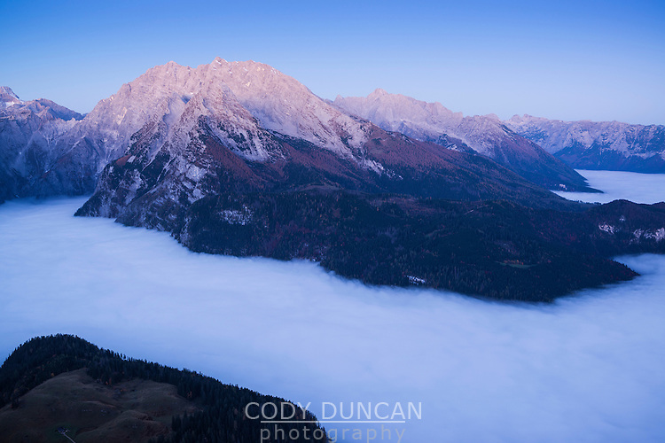 Watzmann (2713m) rises above fog inversion layer at dawn, viewed from summit of Jenner, Berchtesgaden national park, Bavaria, Germany