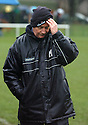 1/2/04          Copyright Pic : James Stewart.File Name : jspa13_spartans.SPARTANS CO-MANAGER MICKEY LAWSON FEELS THE STRAIN....James Stewart Photo Agency, 19 Carronlea Drive, Falkirk. FK2 8DN      Vat Reg No. 607 6932 25.Office     : +44 (0)1324 570906     .Mobile  : +44 (0)7721 416997.Fax         :  +44 (0)1324 570906.E-mail  :  jim@jspa.co.uk.If you require further information then contact Jim Stewart on any of the numbers above.........