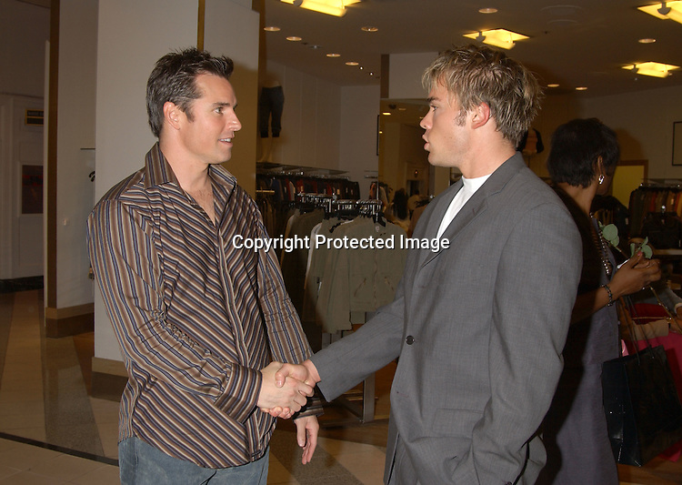 Dan Gauthier and  John-Paul Lavoisier ..at the Saks Fifth Avenue's Key to the Cure Celebrity Launch on September 17, 2003 in New York City. ..Photo By Robin Platzer, Twin Images