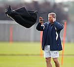 Kenny McDowall throws a bag at Ally McCoist as he chats on the phone at training