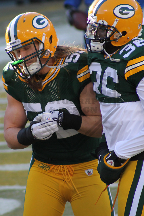 GREEN BAY - JANUARY 2011: Clay Matthews (52) and Nick Collins (36) of the Green Bay Packers during a game on January 2, 2011 at Lambeau Field in Green Bay, Wisconsin. (Photo by Brad Krause)
