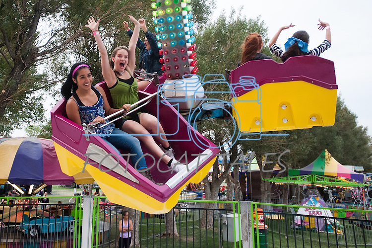 (From Right) Courtney Baxter, 17, and Brianda Diaz, 13, scream while riding a ride during the NV150 Fair at Fuji Park in Carson City, Nev., on Sunday, August 3, 2014.<br /> (Photo By Kevin Clifford)