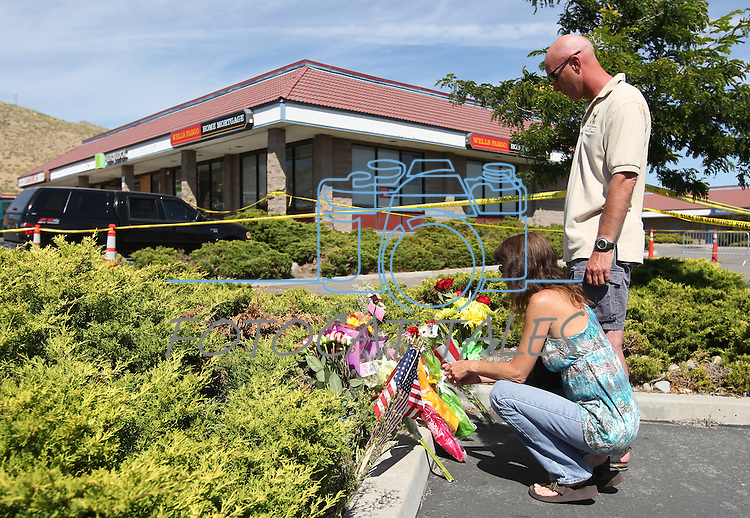 Donna Eldred and Don Bourcier lay flowers at a small memorial outside the IHOP restaurant in Carson City, Nev., on Wednesday, Sept. 7, 2011. (AP Photo/Cathleen Allison)