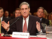 Washington, D.C. - April 14, 2004 --  Robert S. Mueller, III, Director, Federal Bureau of Investigation (FBI), testifies before the National Commission on Terrorist Attacks (9-11 Commission) in Washington, DC on April 14, 2004.<br /> Credit: Ron Sachs / CNP<br /> [RESTRICTION: No New York Metro or other Newspapers within a 75 mile radius of New York City]