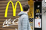 December 24, 2015, Tokyo, Japan - A man walks past a poster announcing the closing of McDonald's largest store in Japan located in Harajuku on January 15, 2016. McDonald's is reportedly looking to sell 15% to 33% of shares of its Japanese subsidiary and gain 100 billion yen ($817 million). McDonald's Holdings Japan is expected a net loss of 38 billion yen during its fiscal year ending on December 31, after scandals of expired chicken in the summer of 2014 and contamination with foreign objects in January 2015. (Photo by Rodrigo Reyes Marin/AFLO)