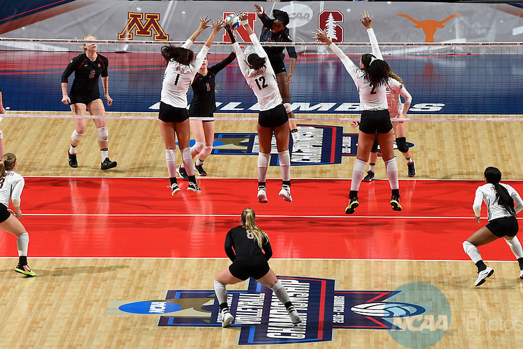 COLUMBUS, OH - DECEMBER 17:  Inky Ajanaku (12) of Stanford University hits a kill against the University of Texas during the Division I Women's Volleyball Championship held at Nationwide Arena on December 17, 2016 in Columbus, Ohio.  Stanford defeated Texas 3-1 to win the national title. (Photo by Jamie Schwaberow/NCAA Photos via Getty Images)