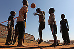 Locals play a morning game of soccer on a dirt pitch in Alexandra Township in Johannesburg, South Africa, during the 2010 World Cup. Sunday 27th June 2010. Photo: (Steve Christo)