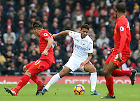 Kyle Naughton of Swansea City forces Roberto Firmino of Liverpool the wrong way as he sharply turns during the Premier League match between Liverpool and Swansea City at Anfield, Liverpool, Merseyside, England, UK. Saturday 21 January 2017