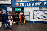 The two teams preparing to walk out on to the pitch before Coleraine (in blue) played Spartak Subotica of Serbia in a Europa League Qualifying First Round second leg at the Showgrounds, Coleraine. The hosts from Northern Ireland had drawn the away leg 1-1 the previous week, however, the visitors won the return leg 2-0 to progress to face Sparta Prague in the next round, watched by a sell-out crowd of 1700.