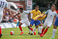 Play continues with Kyle Walker-Peters (Tottenham Hotspur) of England heading forward despite 2 balls being on the field during the International match between England U20 and Brazil U20 at the Aggborough Stadium, Kidderminster, England on 4 September 2016. Photo by Andy Rowland / PRiME Media Images.