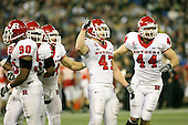 January 5th, 2008:  Rutgers defenders Jamaal Westerman (90), Gary Watts (92), Brandon Renkart (47), and Ryan D'Imperio (44) look to the sideline  during the third quarter of the International Bowl at the Rogers Centre in Toronto, Ontario Canada...Rutgers defeated Ball State 52-30.  ..Photo By:  Mike Janes Photography