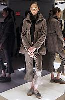 Model in Look 16: Jacquard Jacket Black Sweater Knit Sweatshirt, Blush Top, Jacquard Pant