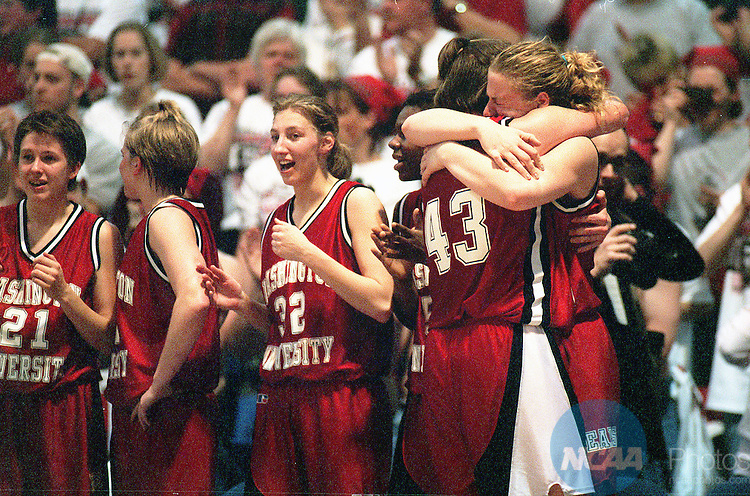 18 MAR 2000:  CenterAlia Fischer (43) of Washington University hugs one of her teammates during the Division 3 Women's Basketball Championship held at the O'Neill Center on the Western Connecticut State University campus in Danbury, CT.  Washington University defeated the University of Southern Maine 79-33 for the championship title.  Jeff Holt/NCAA Photos