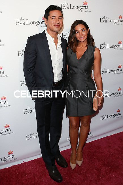 HOLLYWOOD, LOS ANGELES, CA, USA - OCTOBER 09: Mario Lopez, Courtney Mazza arrive at the Eva Longoria Foundation Dinner held at Beso Restaurant on October 9, 2014 in Hollywood, Los Angeles, California, United States. (Photo by David Acosta/Celebrity Monitor)
