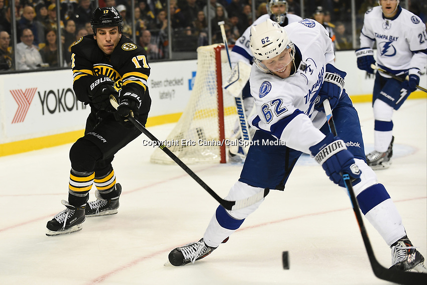 January 13, 2015 - Boston, Massachusetts, U.S. - Boston Bruins left wing Milan Lucic (17) and Tampa Bay Lightning defenseman Andrej Sustr (62) in game action during the NHL match between the Tampa Bay Lightning and the Boston Bruins held at TD Garden in Boston Massachusetts. The Bruins defeated the Lightning 4-3 in regulation time. Eric Canha/CSM
