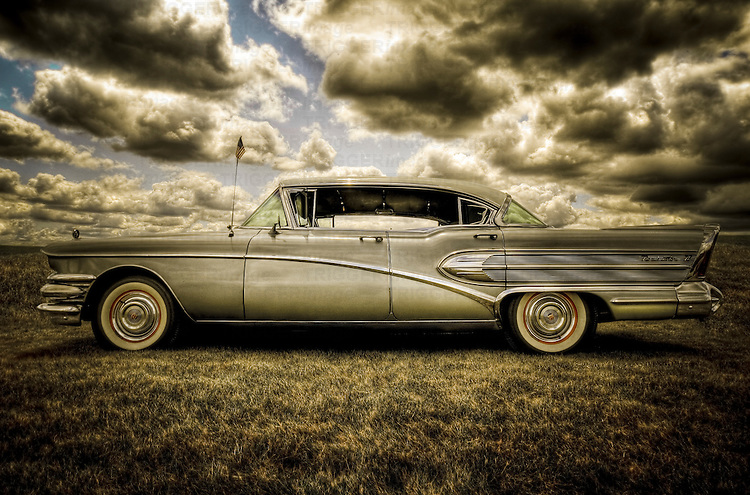 Vintage USA 1958 Buick Roadmaster car with classic fins under stormy sky
