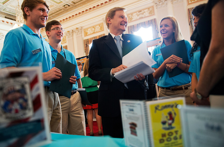 UNITED STATES - AUGUST 01:  Rep. Spencer Bauchus, R-Ala., talks with Aaron Brosz, left, Stephen Hall, and Olivia Brooks, who are high school students from Hueytown, Ala., during a Junior Achievement USA student business competition in Cannon Building.  The Alabama team's idea was a smartphone app for local businesses to advertise with restaurants.  (Photo By Tom Williams/CQ Roll Call)