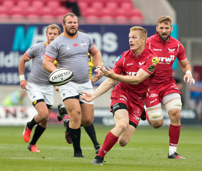 Scarlets' Johnny McNicholl gets the ball away<br /> <br /> Photographer Simon King/CameraSport<br /> <br /> Guinness Pro14 Round 1 - Scarlets v Southern Kings - Saturday 2nd September 2017 - Parc y Scarlets - Llanelli, Wales<br /> <br /> World Copyright &copy; 2017 CameraSport. All rights reserved. 43 Linden Ave. Countesthorpe. Leicester. England. LE8 5PG - Tel: +44 (0) 116 277 4147 - admin@camerasport.com - www.camerasport.com