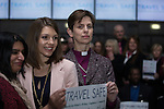 © Joel Goodman - 07973 332324 . 09/02/2015 . Manchester , UK . LIBBY LANE (3rd from left), the Bishop of Stockport , carries out her first public engagement since being ordained as the first woman Bishop in the Church of England . Bishop Libby Lane meets victims of human trafficking at Manchester Airport's Terminal 2 Arrival Lounge and speaks in support of efforts to clamp down on human trafficking . Photo credit : Joel Goodman