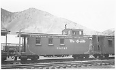 Side view of long caboose #04343 at Silverton, flying herald.<br /> D&amp;RGW  Silverton, CO  Taken by Maxwell, John W. - 5/30/1954
