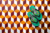 Rubber Flip Flops or Sandals from a Buddhist Monk on the floor of the Monastery entrance in Battambang, Cambodia.