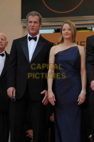 MEL GIBSON & JODIE FOSTER .attends 'The Beaver' premiere 64th International Cannes Film Festival, France, 17th May 2011..half 3/4 length one shoulder blue navy dress   tuxedo tux bow tie   long maxi .CAP/PL.©Phil Loftus/Capital Pictures.