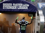 Seattle Seahawks wide receiver Sidney Rice runs onto the field during introductions before their game with the San Francisco 49ers  at CenturyLink Field in Seattle, Washington on September 15, 2013. The Seahawks beat the 49ers 29-3. ©2013. Jim Bryant Photo. ALL RIGHTS RESERVED.