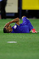 AFC Wimbledon's Liam Trotter lays injured during the Sky Bet League 1 match between AFC Wimbledon and MK Dons at the Cherry Red Records Stadium, Kingston, England on 22 September 2017. Photo by Carlton Myrie / PRiME Media Images.