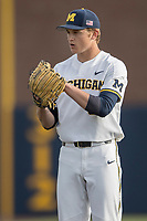 Michigan Wolverines pitcher Michael Hendrickson (30) looks to his catcher for the sign against the Michigan State Spartans during the NCAA baseball game on April 18, 2017 at Ray Fisher Stadium in Ann Arbor, Michigan. Michigan defeated Michigan State 12-4. (Andrew Woolley/Four Seam Images)