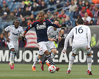 New England Revolution forward Teal Bunbury (10) on the attack. In a Major League Soccer (MLS) match, the New England Revolution (blue/white) tied Vancouver Whitecaps FC (white), 0-0, at Gillette Stadium on March 22, 2014.