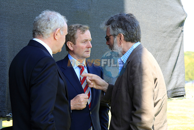 Taoiseach Enda Kenny cornered by Martin McGuinness and Gerry Adams<br /> at the renaming of the Mary McAleese Boyne Valley bridge at Oldbridge house<br /> Picture:  Fran Caffrey / www.newsfile.ie