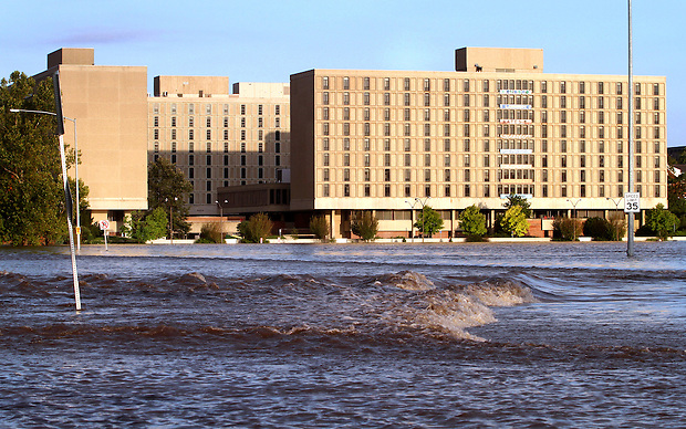 Dormitories on the Iowa State University campus are met by flowing flood water Wednesday, August 11, 2010 from the flooded South Skunk River and Squaw Creek.