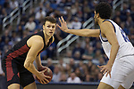 San Diego State forward Yanni Wetzell (5) is guarded by Nevada forward Johncarlos Reyes (12) during the second half of a basketball game played at Lawlor Events Center in Reno, Nev., Saturday, Feb. 29, 2020. (AP Photo/Tom R. Smedes)