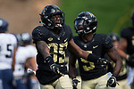 Greg Dortch (89) of the Wake Forest Demon Deacons celebrates after his 43-yard touchdown catch and run during first quarter action against the Utah State Aggies at BB&T Field on September 16, 2017 in Winston-Salem, North Carolina.  (Brian Westerholt/Sports On Film)