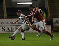 Dougie Imrie under pressure from Josh Magennis in the Aberdeen v St Mirren Scottish Communities League Cup match played at Pittodrie Stadium, Aberdeen on 30.10.12.