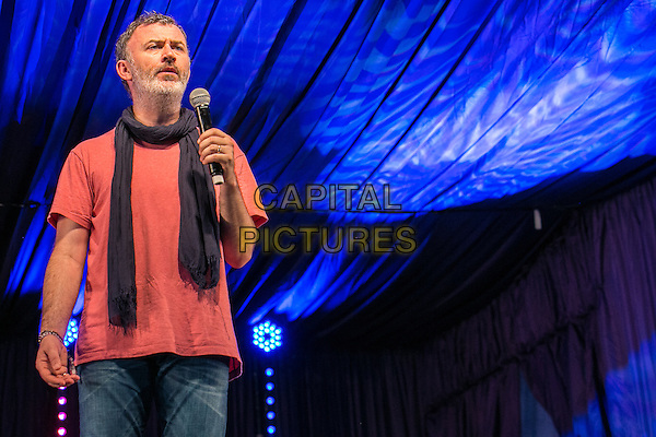19th July 2014: Irish comedian Tommy Tiernan plays the Comedy Arena on the third day of the 9th edition of the Latitude Festival, Henham Park, Suffolk. <br />  <br /> CAP/PP/HOG<br /> &copy;HOG/PP/Capital Pictures